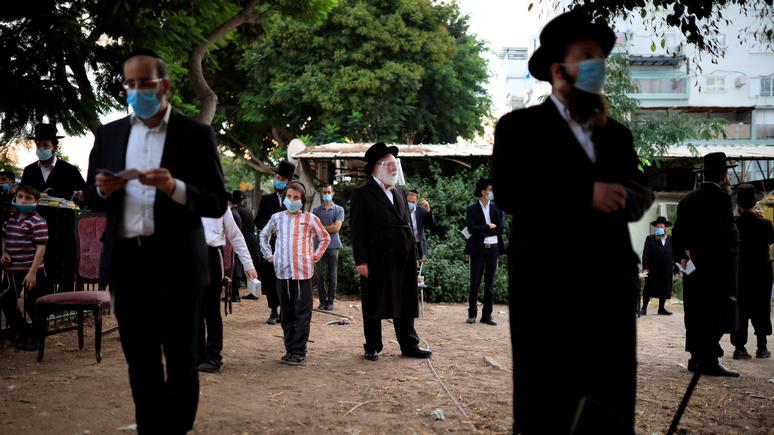 Израиль первым в мире возобновляет национальный карантин